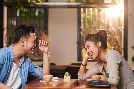 Couple have coffee in coffee shop.